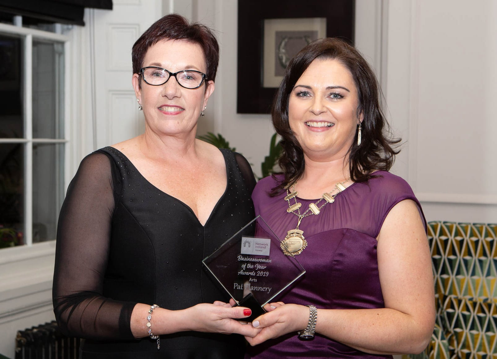 Pat Flannery Receiving Business Woman of the Year Award in Arts Category from President of Network Galway Ireland.jpeg