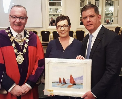 Pat Flannery Galway Based Irish Artist Presenting a Painting of Galway hooker Boats to Mayor of Boston Marty Walshe.jpeg